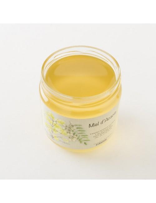 Intérieur d'un pot de miel d'acacia